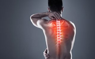 Rearview shot of a young man in the studio with cgi highlighting his back injury